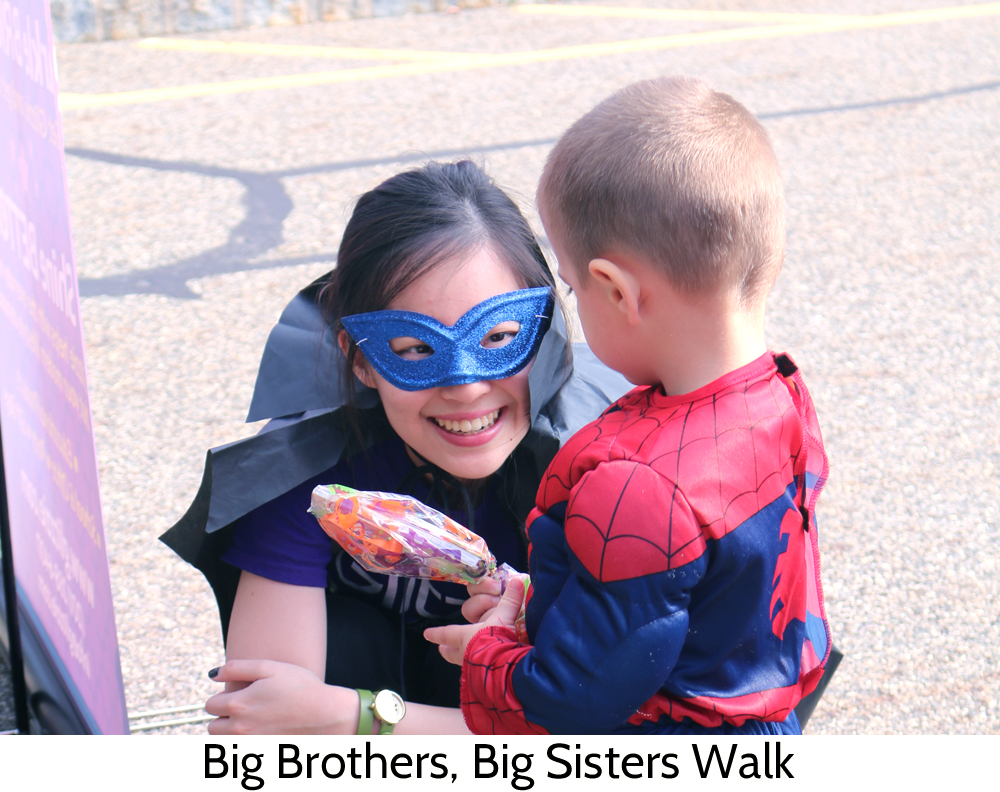 Tang Tang with a youngster in costume at the Big Brothers, Big Sisters walk in New Jersey
